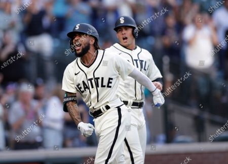 Stock Picture of Seattle Mariners' J.P. Crawford celebrates at home with Dylan Moore behind, after hitting a grand slam off Tampa Bay Rays starting pitcher Josh Fleming during the second inning of a baseball game, in Seattle