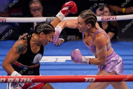 Mikaela Mayer hits Erica Farias, of Argentina, in a WBO female junior lightweight title fight, in Las Vegas