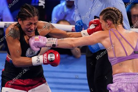 Erica Farias, of Argentina, left, and Mikaela Mayer trade blows in a WBO female junior lightweight title fight, in Las Vegas