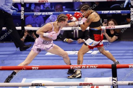 Mikaela Mayer (L) of the USA in action against Erica Farias (R) of Argentina during their 10 round WBO (World Boxing Organization) Female Junior Lightweight Title fight at The Theater at Virgin Hotels in Las Vegas, Nevada, USA, 19 June 2021.