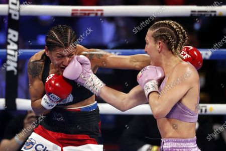 Stock Image of Mikaela Mayer (R) of the USA in action against Erica Farias (L) of Argentina during their 10 round WBO (World Boxing Organization) Female Junior Lightweight Title fight at The Theater at Virgin Hotels in Las Vegas, Nevada, USA, 19 June 2021.
