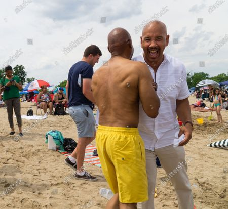 Eric Adams greets voters with Bronx Borough President Ruben Diaz Jr. on the final campaign weekend.