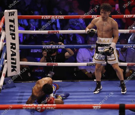 Naoya Inoue (R) of Japan stands over Michael Dasmarinas (L) of the Philippines after knocking down Dasmarinas during their 12 round WBA/IBF Bantamweight Title fight at The Theater at Virgin Hotels in Las Vegas, Nevada, USA, 19 June 2021.