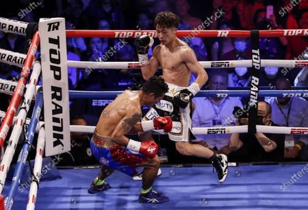 Naoya Inoue (R) of Japan in action against Michael Dasmarinas (L) of the Philippines during their 12 round WBA/IBF Bantamweight title fight at The Theater at Virgin Hotels in Las Vegas, Nevada, USA, 19 June 2021.