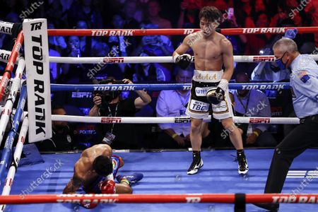 Naoya Inoue (R) of Japan in action against Michael Dasmarinas (L) of the Philippines during their 12 rounds WBA/IBF Bantamweight Title fight at The Theater at Virgin Hotels in Las Vegas, Nevada, USA, 19 June 2021.