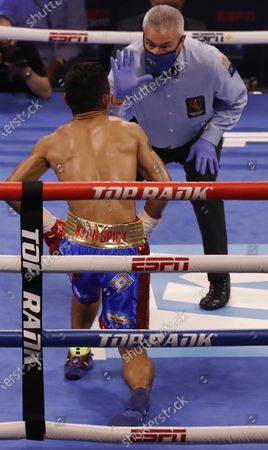 The official counts to Michael Dasmarinas of the Philippines after being knocked down during his 12 round WBA/IBF Bantamweight Title fight against Naoya Inoue of Japan at The Theater at Virgin Hotels in Las Vegas, Nevada, USA, 19 June 2021.