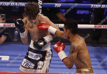 Naoya Inoue (L) of Japan in action against Michael Dasmarinas (R) of the Philippines during their 12 round WBA/IBF Bantamweight title fight at The Theater at Virgin Hotels in Las Vegas, Nevada, USA, 19 June 2021.