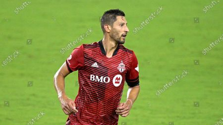 Toronto FC defender Omar Gonzalez (44) follows a play during the second half of an MLS soccer match against Orlando City, in Orlando, Fla