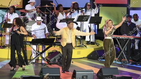 """Billy Davis, center, and Marilyn McCoo, right, perform at a special screening of """"Summer of Soul"""" at The Richard Rodgers Amphitheater at Marcus Garvey Park, in New York"""