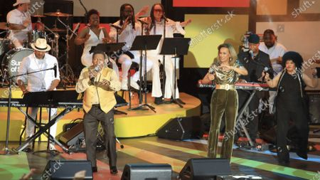 """Stock Image of Billy Davis, front left, and Marilyn McCoo, to his left, perform at a special screening of """"Summer of Soul"""" at The Richard Rodgers Amphitheater at Marcus Garvey Park, in New York"""