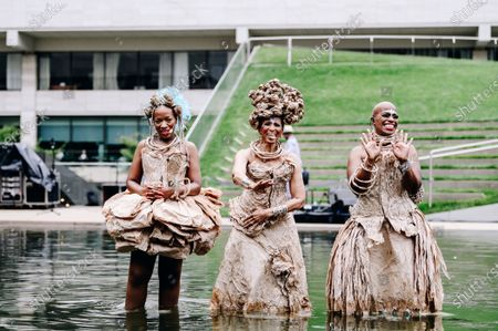 Stock Picture of Kimberly Nichole, Nona Hendryx and Marcelle Lashley peform in the Milstein Pool at Hearst Plaza in Lincoln Center.