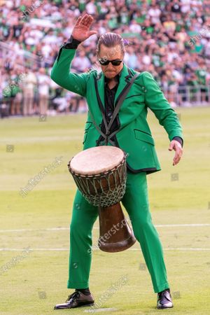 Austin FC co-owner and Minister of Culture Matthew McConaughey plays bongos on the field before the match between Austin FC and the San Jose Earthquakes on June 19, 2021, in Austin, Texas.