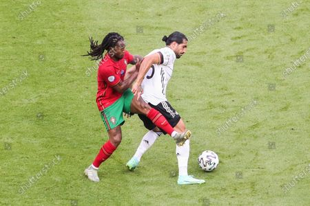 (210620) - MUNICH, June 20, 2021 (Xinhua) - Emre Can (R) of Germany controls the ball under the defense of Renato Sanches of Portugal during the UEFA Euro 2020 Championship Group F match in Munich, Germany, June 19, 2021.