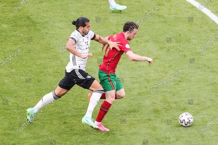 (210620) - MUNICH, June 20, 2021 (Xinhua) - Emre Can (L) of Germany lives with Diogo Jota of Portugal during the UEFA Euro 2020 Championship Group F match in Munich, Germany, June 19, 2021.