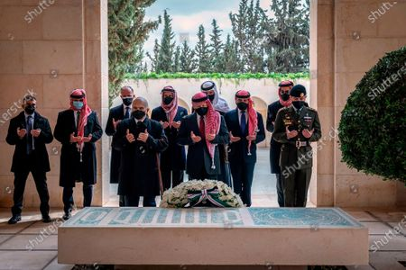 From the Royal Court twitter account, shows Jordan's King Abdullah II, center, Prince Prince Hamzah, second left, and others during a visit to the tomb of the late King Hussein, in Amman Jordan. Jordan's version of a trial of the century gets under way as early as . A relative of King Abdullah II and a former chief of the royal court will be ushered into the defendants' cage at the state security court to face sedition charges. They are accused of conspiring with Prince Hamzah, a half-brother of the king, to foment unrest against the monarch
