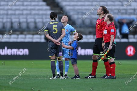 A young fan completes the coin toss with club captains Mark Milligan of Macarthur FC and Scott Jamieson Melbourne City at the A-League semi final; Netstrata Jubilee Stadium, Sydney, New South Wales, Australia; A League Football, Melbourne City FC versus Macarthur FC.