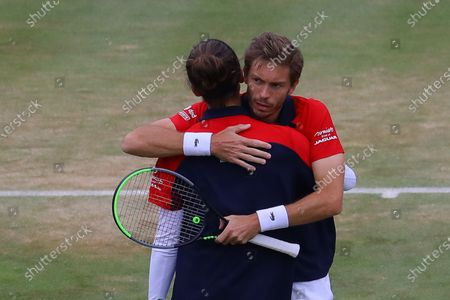 France's Pierre-Hugues Herbert (L) and France's Nicolas Mahut (R) celebrate winning the mens doubles final against United States of America's Reilly Opelka and Australia's John Peers during their finals match at the Cinch Championships at the Queen's Club in London, Britain, 20 June 2021.