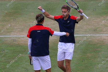 Stock Photo of France's Pierre-Hugues Herbert (L) and France's Nicolas Mahut (R) celebrate winning the mens doubles final against United States of America's Reilly Opelka and Australia's John Peers during their finals match at the Cinch Championships at the Queen's Club in London, Britain, 20 June 2021.