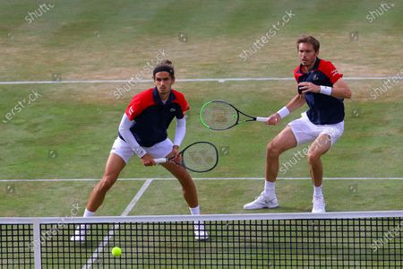 France's Pierre-Hugues Herbert (L) and France's Nicolas Mahut (R) in action in the mens doubles final against United States of America's Reilly Opelka and Australia's John Peers during their finals match at the Cinch Championships at the Queen's Club in London, Britain, 20 June 2021.