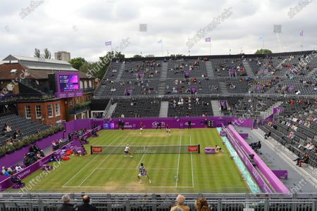 France's Pierre-Hugues Herbert and France's Nicolas Mahut in action in the mens doubles final against United States of America's Reilly Opelka and Australia's John Peers during their finals match at the Cinch Championships at the Queen's Club in London, Britain, 20 June 2021.