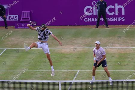 United States of America's Reilly Opelka (L) and Australia's John Peers (R) in action against France's Pierre-Hugues Herbert and France's Nicolas Mahut in the doubles final at the Cinch Championships at the Queen's Club in London, Britain, 20 June 2021.