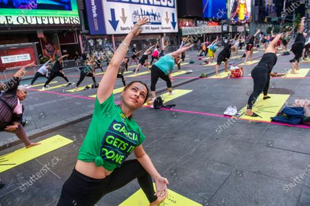 Monika Hansen and other yogis participate in Solstice in Times Square: Mind Over Madness Yoga, an annual all-day outdoor yoga event in New York's Times Square