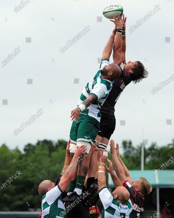 Malon Al-Jiboori of Ealing Trailfinders and Michael Rhodes of Saracens compete for the ball in the air