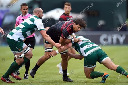 Michael Rhodes of Saracens takes on the Ealing Trailfinders defence