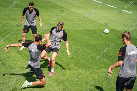 Stock Image of Denmark players Andreas Christensen (top), Jens Stryger Larsen and Yussuf Yurary Poulsen (L) attend a training session in Elsinore, Denmark, 20 June 2021. Denmark will face Russia in their UEFA EURO 2020 soccer tournament group B match on 21 June 2021.