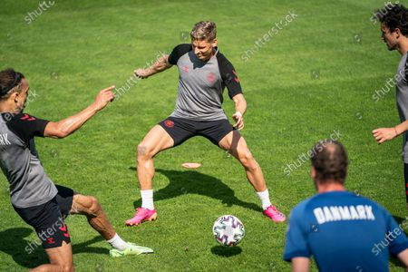 Denmark players Yussuf Yurary Poulsen (L), Thomas Delaney (R) and Jens Stryger Larsen attend a training session in Elsinore, Denmark, 20 June 2021. Denmark will face Russia in their UEFA EURO 2020 soccer tournament group B match on 21 June 2021.