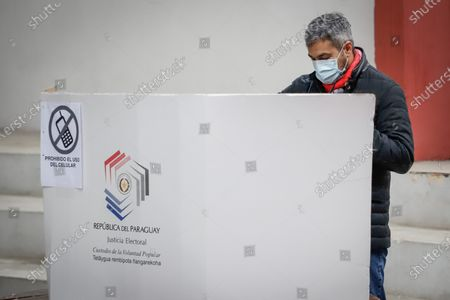 President of Paraguay Mario Abdo Benitez votes at the Colorada Section No. 5 in the 2021 internal party elections, in Asuncion, Paraguay, 20 June 2021. Paraguayans vote in the party elections from which the candidates for the municipal elections on October 10 will emerge, a process that for the first time is carried out with unlocked lists and a electronic voting. The Colorado Party, led by Abdo Benitez, is the one with the largest number of candidates and qualified polling stations, as well as the census, close to two and a half million, according to data from the centennial formation.