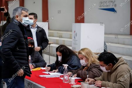 President of Paraguay Mario Abdo Benitez (L) arrives at the Colorada Section No. 5 to cast his vote in the 2021 internal party elections, in Asuncion, Paraguay, 20 June 2021. Paraguayans vote in the party elections from which the candidates for the municipal elections on October 10 will emerge, a process that for the first time is carried out with unlocked lists and a electronic voting. The Colorado Party, led by Abdo Benitez, is the one with the largest number of candidates and qualified polling stations, as well as the census, close to two and a half million, according to data from the centennial formation.