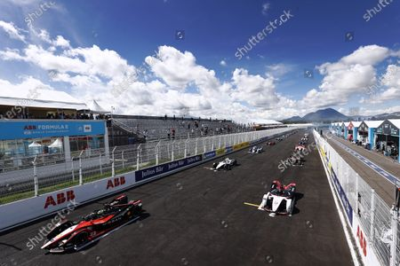 Oliver Rowland (GBR), Nissan e.Dams, Nissan IMO2, and Pascal Wehrlein (DEU), Tag Heuer Porsche, Porsche 99X Electric, prepare to lead the field away at the start during the 2021 Formula E Round 9 - Puebla E-Prix