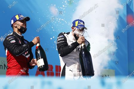 Pascal Wehrlein (DEU), Tag Heuer Porsche, 2nd position, and Edoardo Mortara (CHE), Venturi Racing, 1st position, celebrate with Champagne during the 2021 Formula E Round 9 - Puebla E-Prix
