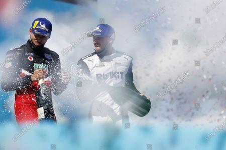 Pascal Wehrlein (DEU), Tag Heuer Porsche, 2nd position, and Edoardo Mortara (CHE), Venturi Racing, 1st position, celebrate on the podium during the 2021 Formula E Round 9 - Puebla E-Prix