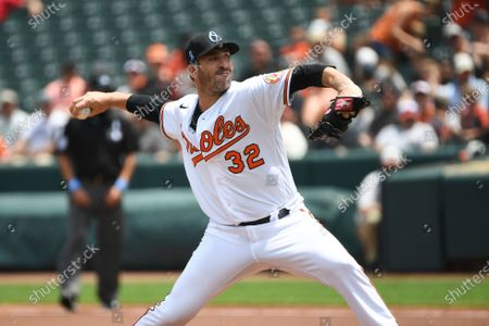 Baltimore Orioles starting pitcher Matt Harvey (32) throws a pitch during the first inning of a baseball game against the Toronto Blue Jays, in Baltimore