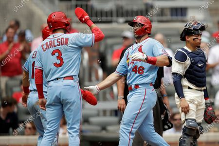 St. Louis Cardinals' Paul Goldschmidt (46) is congratulated by Dylan Carlson (3) after hitting a three run home run off Atlanta Braves' Josh Tomlin during the fifth inning of the first baseball game of a doubleheader, in Atlanta