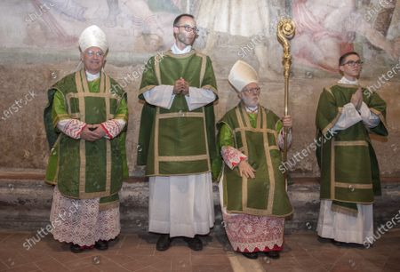 Card. Celestino Aos Braco (2 from R) and Mgr. Alberto Ricardo Lorenzelli Rossi (L), pose during Mass for his taking possession of the Title of Saints Nereus and Achilleus at Terme of Caracalla in Rome.