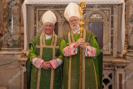 Stock Image of  Card. Celestino Aos Braco (R) flanked by Mgr. Alberto Ricardo Lorenzelli Rossi (L), pose during Mass for his taking possession of the Title of Saints Nereus and Achilleus at Terme of Caracalla in Rome.