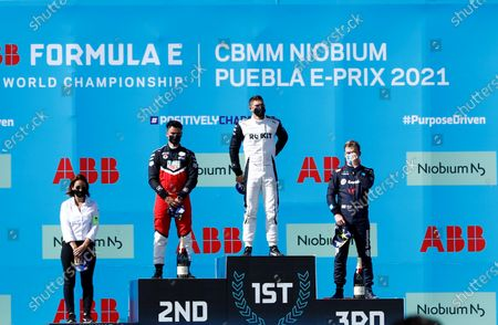 Swiss Edoardo Mortara (2-R), first place, German Pascal Wehrlein (2-L), second place and Neo Zealand Nick Cassidy (R), third place, stand on the podium after the second race of Formula E championship, at Miguel E. Abedin racecar in the state of Puebla, Mexico, 20 June 2021.