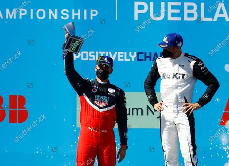 German Pascal Wehrlein (L), of Porsche, celebrates his second place next to Swiss Edoardo Mortara (first place), of Rokit Venturi Racing, after the second race of Formula E championship, at Miguel E. Abedin racecar in the state of Puebla, Mexico, 20 June 2021.
