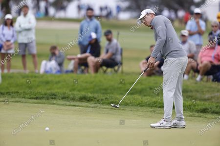 Stock Photo of Matt Fitzpatrick of England putts on the sixth hole during the final round of the 2021 US Open golf tournament on the South Course of the Torrey Pines Golf Course in San Diego, California, USA, 20 June 2021.