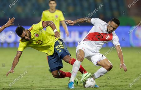 Colombia's Miguel Borja, left, and Peru's Alexander Callens battle for the ball during a Copa America soccer match at Olimpico stadium in Goiania, Brazil