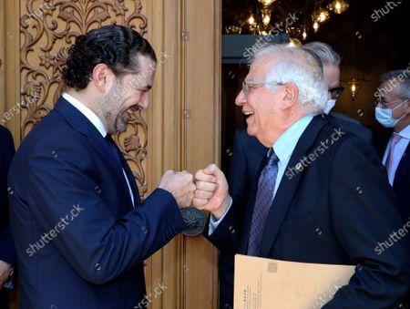 Stock Photo of En esta imagen del sábado 19 de junio de 2021 difundida por el gobierno libanés, el primer ministro designado de Líbano, Saad Hariri, saluda al ministro de política exterior de la Unión Europea, Josep Borrell, chocando los puños, en Beirut
