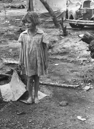 Stock Photo of Dirty child living in unsanitary conditions at the migratory camp, Texas, United States, 1939