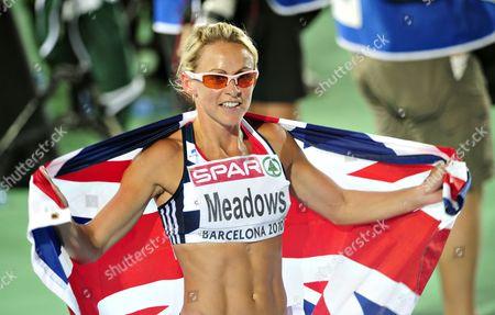 Jennifer (Jenny) Meadows celebrates after winning bronze in the women's 800m final