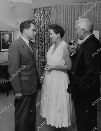 Richard M. Nixon (L) talking with Norman Chandler (R) and his wife.