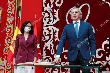 Madrid's regional Health Minister Enrique Ruiz Escudero (R), next to Madrid's regional President Isabel Diaz Ayuso (L), during the regional Ministers' swear-in ceremony in Madrid, Spain, 21 June 2021. Ayuso won regional snap elections held 04 May 2021.