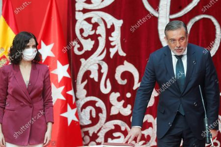 Madrid's regional Justice Minister Enrique Lopez (R), next to Madrid's regional President Isabel Diaz Ayuso (L), during the regional Ministers' swear-in ceremony in Madrid, Spain, 21 June 2021. Ayuso won regional snap elections held 04 May 2021.