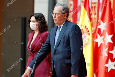 Madrid's regional Education and Youth Minister Enrique Ossorio (R), next to Madrid's regional President Isabel Diaz Ayuso (L), during the regional Ministers' swear-in ceremony in Madrid, Spain, 21 June 2021. Ayuso won regional snap elections held 04 May 2021.